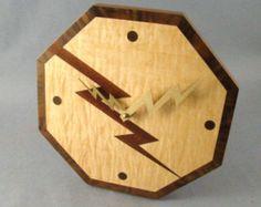 Lighting bolt wall clock of figured maple, sapele and walnut