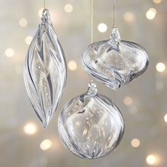 Artful glass ornaments emit an enchanting glow from the swirls and facets inherent in their flowing designs. Translucent ornaments feature integrated glass hanging loops.