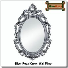 Silver Royal Crown Wall Mirror - Decorate your wall with a royally beautiful work of art! This gorgeous oval wall mirror has a wooden frame that's carved with fantastic flourishes. The design is highlighted by the regal burnished silver finish. This will look great in your bedroom, powder room, and beyond.