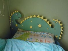 A dinosaur headboard I made for my son's bedroom.