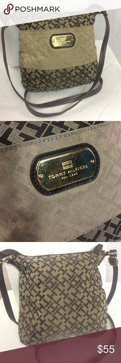 """Tommy Hilfiger Brown/Tan Monogram Crossbody Purse This cute crossbody has been preloved, but is still in good condition!  The gold nameplate on the front is scratched, & there are two not very noticeable spots on the Tan patch on the front.   It is all manmade materials.  There is a big pocket on the front, & two open pockets & one zipper pocket inside.  The dimensions measure about 9"""" x 8.5"""" with an adjustable strap measuring about 48"""" at the longest length.  Reasonable official offers may…"""