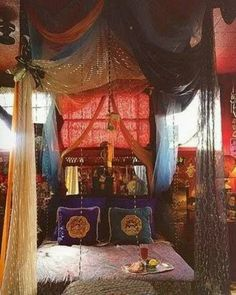 Bohemian hippie gypsy bed. Bed itself looks a bit stiff but love the draped scarves and silks