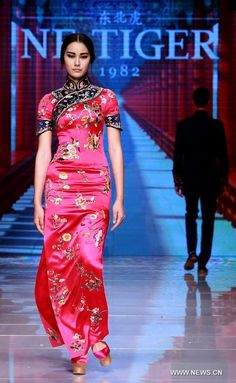 """Models present creations by Ne Tiger Haute Couture 2015 collection with the theme """"Qipao"""" during the opening show for the China Fashion Week in Beijing, China, October 25, 2015.  https://www.pinterest.com/infoseekchina/chinese-entertainment-news/"""