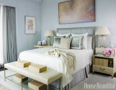 In a New York City pied-à-terre — designed by Jim and Phoebe Howard as part of the 2010 Designer Visions project — the master bedroom is a mix of dreamy blues and soft, satin fabrics.