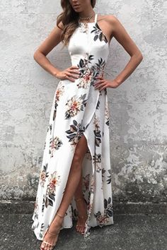 Make heads turn in this maxi dress. It is adorned with sleeveless, back lace-up, cut out and side split. Pair it with high heels. With floral print the dress makes you perfect.