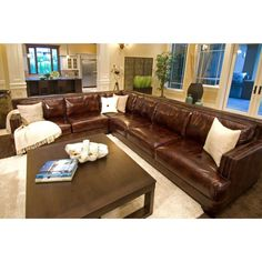 Add a comfortable space for relaxing with the family with this sectional sofa from Elements Fine Home Furnishings. Featuring top-grain leather upholstery in a saddle-brown color, this sectional sofa b