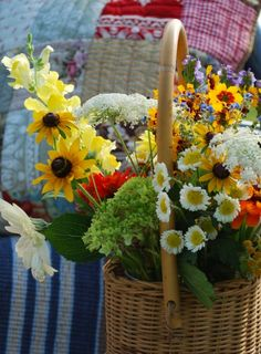 Oh the flowers are perfect. It shows off all the quilts we have today at the Country Fair................
