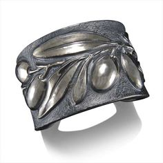 Olive Cuff, Davide Bigazzi. employing chasing and repousse. After drawing the design on the cuff, Bigazzi forms the contours of the design from the back of the bracelet by using blunt hammer-struck punches (repousse). He then adds details from the front of the bracelet using smaller, specially shaped punches (chasing). Interior circumference is 6.75 inches.