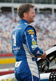 Dale Earnhardt Jr. Photos Photos - Dale Earnhardt Jr., driver of the #88 Nationwide Patriotic Chevrolet, stands by his car during qualifying for the Monster Energy NASCAR Cup Series Coca-Cola 600 at Charlotte Motor Speedway on May 25, 2017 in Charlotte, North Carolina. - Charlotte Motor Speedway - Day 1
