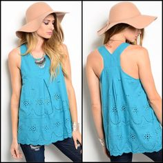"Teal Sleeveless Woven Top Teal sleeveless woven top features eyelet detail and scooped neckline.  Comfy, flowy fit. Additional details:  🔹 Color:  Teal (also avail in white) 🔹 Fabric: 100% cotton 🔹 Bust (across laid flat): 17"" 🔹 Length: 26.5"" 🔹 Condition: New without sales tags Tops"