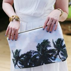 Make this printed pouch with a flat bottom and a metallic zipper for a chic and polished accessory!