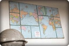 so cool! an old map glued to canvases with a border, i believe. super cheap and creative.