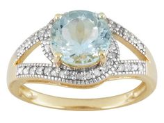 Aquamarine blue is unbeatable. There's such elegance that goes along with this stone. | 1.45ct Round Aquamarine With .11ctw Round White Diamonds 10k Yellow Gold Ring