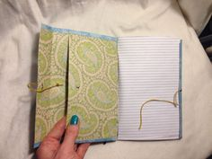 "7""x5"" handmade notebook by Picardian Paper Co., Kapa'a, HI  Inner pockets, outer tie closure  Facebook.com/PicardianPapers  email- PicardianPapers@post.com"