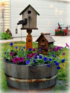Wine barrel with cute bird houses and petunias.