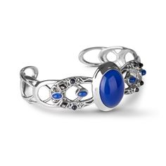 Calming blue and sterling silver create this fabulous cuff! Highly polished sterling silver swirls make the band of this beautiful piece. Its vivid blue agate cabochon with iolite and gray mother of pearl accents are a winning combination of color and style.