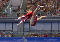 Switzerland's Ilaria Kaeslin leaps from the uneven bars as she competes in the women's qualifying round of the Artistic Gymnastics World Championships at the Guangxi Gymnasium in Nanning, capital of southwest China's Guangxi Zhuang Autonomous on Oct. 5.