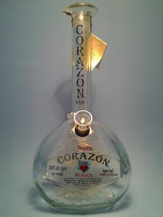 (1) Corazon Tequila Water Pipe Liquor Bottle Water Pipe    MADE FROM A RECYCLED LIQUOR BOTTLE    *QUANTITY: ( 1 ) Water pipe    This item is not to be used for illegal substances, or by any one under the age of 18    Purchaser Resumes all responsibility for all local and federal laws Seller.    All logos, names, and trademarks on bottles belong to and are property of the company in which they represent.