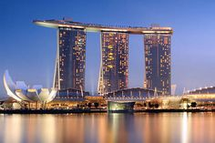 Is that a ship on top of three buildings? nope, that's a skypark with a huge pool. marina bay sands in singapore.