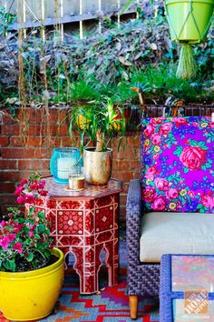 From Design Sponge blogger Grace Bonney's book, a bohemian style patio with black brick walls, suzani covered bench and plenty of plants. Description from en.paperblog.com. I searched for this on bing.com/images