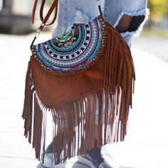 A stylish suede cross body bag coming in a standout rustic brown. With tassels running down the sides it will be the perfect finish for any boho outfit - whether it's a classic denim shorts and croche