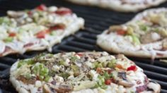 Personal pizzas are easy and delicious when made on the grill.