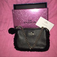 """New in original box Coach evening purse ✨ $100✨ Removed tags but never used ! So so adorable Has heavy silver chain 12"""" long . ✨                   Bag is 7"""" X 4 1/2"""" Has a black Pom Pom and same material as piping around outer edge of bag . Coach tag on top with handle . Smoke free home , only owned this sweet bag for a few months ! Authentic , purchased at Dillard's Coach Bags Mini Bags"""