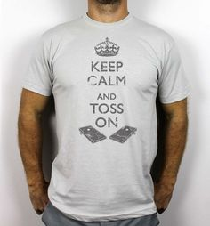 Our American Apparel Keep Calm and Toss On Premium Cornhole Tshirt. For more colors and designs go to www.victorytailgate.com!
