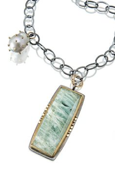 """3"""" long Brazilian aquamarine set in 22k gold and oxidized silver with a pearl studded with 18k gold. http://sydneylynch.com"""