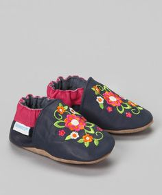 {Navy Blossom Bootie} Both of our girls used Robeez. They are the only thing that would stay on their feet. This style is lovely.