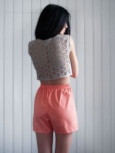 $24 Laser cut womens top in warm grey by Dionisis Chalikias for muchö.  I wanted somehow to add more dimension to the fabric  by creating a new type of lace on t-shirts and tops for this summer, Dionisis says.  After discovering the potential of using laser cutting technology on making jewelry,  we wanted to experiment even more on fabric.  So, I started to create simple 80s inspired patterns of sleeveless tees and lose fit tops.  Then I created motifs, shapes, skulls and abstract forms out…