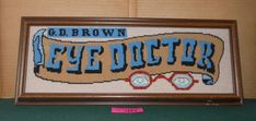 "Vintage Decorative or Advertising ""Eye Doctor"" Framed Needlepoint Wallhanging"