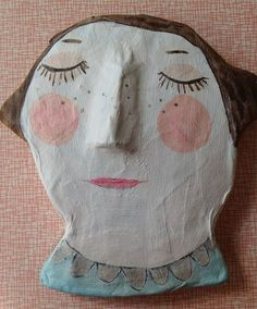 more papier mache. this is a small wall piece that i had so much fun making. i love painting faces - bringing little creatures and people to life! she's sleeping and possibly making me a little tiny bit drowsy, too...... (she's for sale, by the way)
