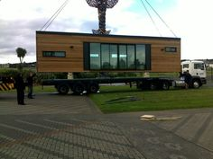 Shipping Container House by Cubular, New Zealand - one of 2 40' containers being delivered.