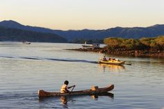 This was taken when then sun set in Kalong Island, Komodo, East Nusa Tenggara, Indonesia. Locals called the small boat as 'sampan'. This sampan is used to sell beverages to tourists' boats who stay the night on the island on board.
