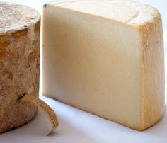 """Lancashire epitomizes the """"butter crumble"""" texture so characteristic of British cheeses. Lancashire is aged for 5 - 8 months to the point that it develops a delicate, lemony flavor and a long-lasting mellow tang. Try this cheese with Riesling or Gewürztraminer, a Pinot Noir, or a dark British Ale."""