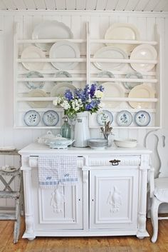 White Painted Plate rack with blue and white dishes and White Chest. -- Vibeke Design