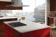 artificial stone countertop and red kitchen cabinets