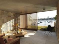 The vertical elements of timber screens are organized at varied angles to open up different aspects.