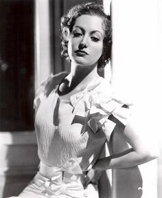 Also, Joan Crawford and her multiple bows - c. 1930s How can she wear this and not look twee. Magic.