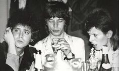 Lou Reed, Mick Jagger and David Bowie hanging out together at Café Royale at the celebrity wrap party after Bowie's last Ziggy Stardust performance, 1973.  Photo by Mick Rock.