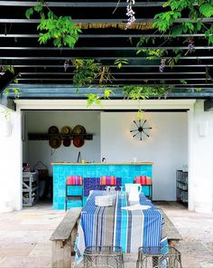 Outdoor dining area with blue accents