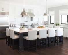 Modern white kitchen, large island, dark hardwood - Kitchen by Kelly Deck