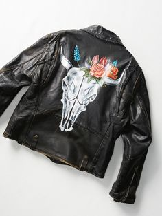 Vintage Painted Moto Jacket | Vintage from the 1980s handpainted moto jacket featuring lining, 3 front zipper pockets, patches, and handpainted bull skull on back * This one-of-a-kind piece was purchased by our vintage buyer for a specially curated collection of ballet meets punk rock styles. Channel your inner tomboy and evoke the essence of the '90s in rocking graphic tees, leather motorcycle jackets, cheetah print coats, and crinoline skirts.