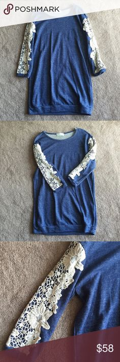 """Denim Sweatshirt Lace Tunic Denim Sweatshirt Lace Tunic. Can be worn as dress or tunic. Sweatshirt material, denim look, crochet lace covers sleeves. Brand new from boutique. Approx 32"""" long. Size small. So adorable! Boutique Tops Tunics"""