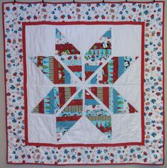 Completed Snow-Kissed Star quilt by flickrdeb50, via Flickr