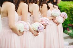 bridesmaids in blush pink carrying pastel hued bouquets | www.closertolovephotography.com