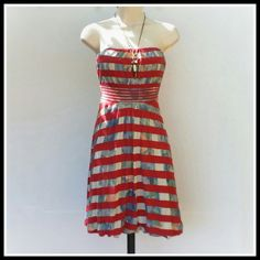 American Rag Strapless  Dress Red stripes over floral print dress with tie in the back, a bubble hem and fully lined. 50% Rayon, 50% polyester. Great condition. American Rag Dresses Strapless