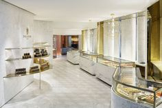 Gold portals accent back-lit angled walls in the shop's chic interior.