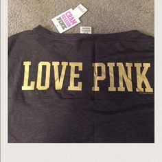 Pink jersey! University of Washington It is grey with a silky gold 61 on the front and on the top left of the 6 there is an 18 stitched on. It has a gold W on easy arm sleeve and on the back it says love pink. It is from the collegiate collection. PINK Victoria's Secret Tops